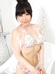 Maria Akamine Asian washes and soaps her body over bath suit