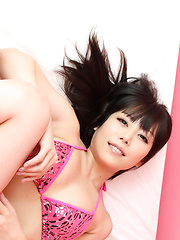 Maria Akamine Asian shows big assets in pink lingerie in her bed