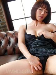 Izumi Manaka in black lingerie enjoys vibrator and sucks shlong