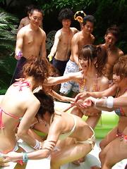 Slim Asian honeys love outdoor oil wrestling