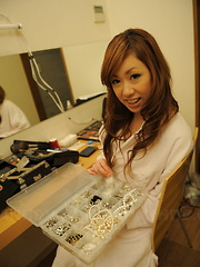 Cute Yurina gets ready in the dressing room