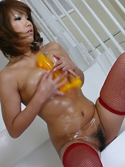 Oiled up Japanese babe loves to fuck herself