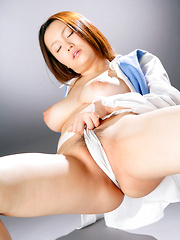 Rika Aiuchi Asian with big nude tits rubs her poonanie with thong